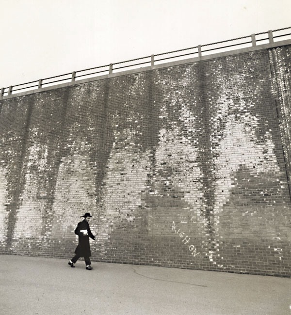 A Hassidic Rabbi Walks across a Highway Underpass, Brooklyn, NY