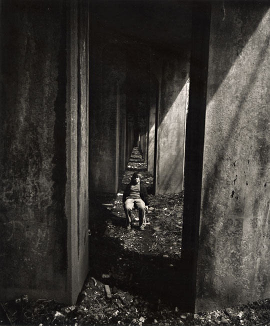 A Boy Sits under an Abandoned Railroad Track, Staten Island, NY