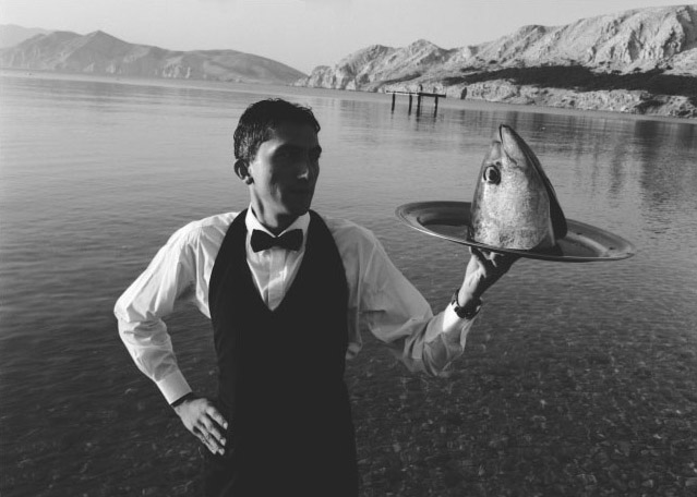 Waiter Serving Fish Head