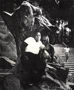 Arthur Tress - In an Old Bronze Statue a Negro Youth Sits in Morningside Park, NYC Click for more Images